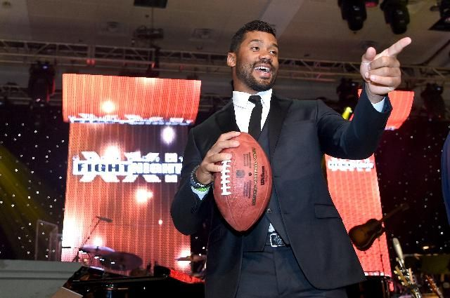 Seattle Seahawks Tickets Most Expensive In NFL On Secondary Market, Up 9% From 2014. Seattle Seahawks quarterback Russell Wilson onstage during Muhammad Ali's Celebrity Fight Night XXI at the Jw Marriott Phoenix Desert Ridge Resort & Spa on March 28, 2015 in Phoenix, Arizona.