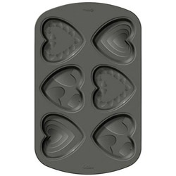@Overstock - Bake and decorate spectacular mini heart cakes for your Valentine's Day celebration. This pan is non-stick for easy removal and is dishwasher safe.  http://www.overstock.com/Crafts-Sewing/Wilton-6-cavity-Heart-Mini-Cake-Pan/5747989/product.html?CID=214117 $11.98