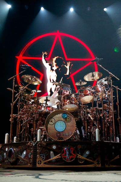 Neil Peart of Rush - just the mention of Rush zaps me back to being 14 and dateless, like most Rush fans at one point.  He ranks up there with the best of all time, in spite of playing rock music, which for drummers is child's play compared to jazz.