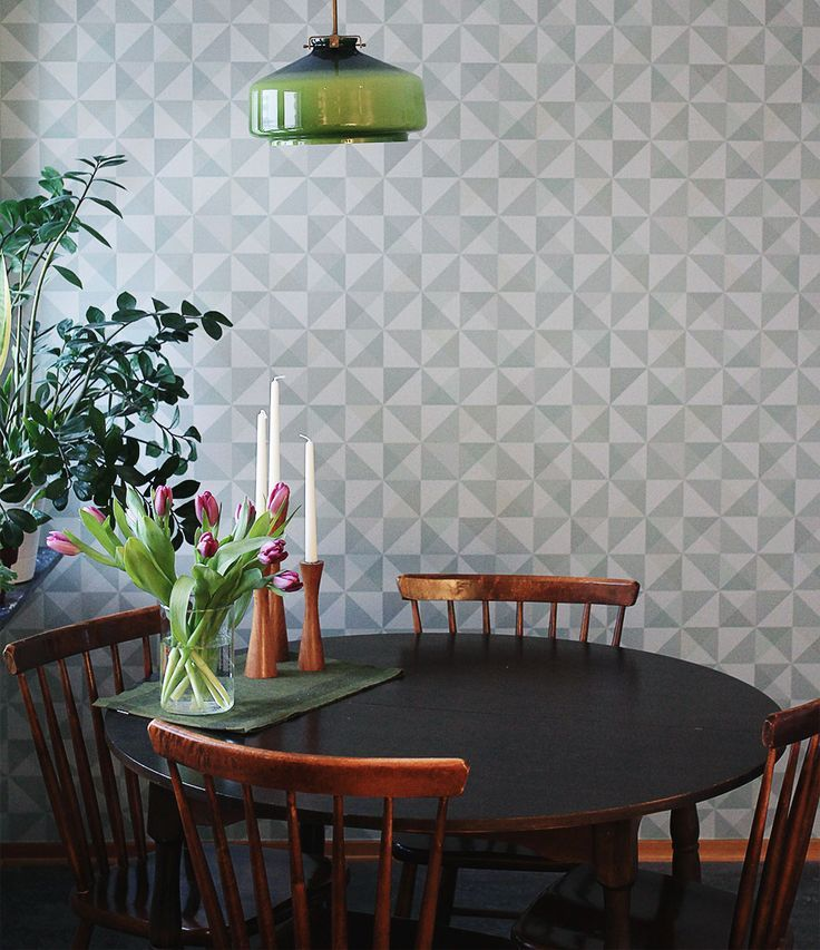 Eco dimensions wallpaper looks stunning in this retro styled dining room. The mix of colours works beautifully and the wallpaper give a real designer touch to an otherwise simple space.  (scheduled via http://www.tailwindapp.com?utm_source=pinterest&utm_medium=twpin)