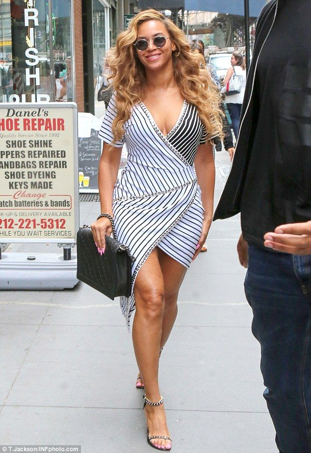 Beyonce flaunts her curves in a striped wrap dress in New ...