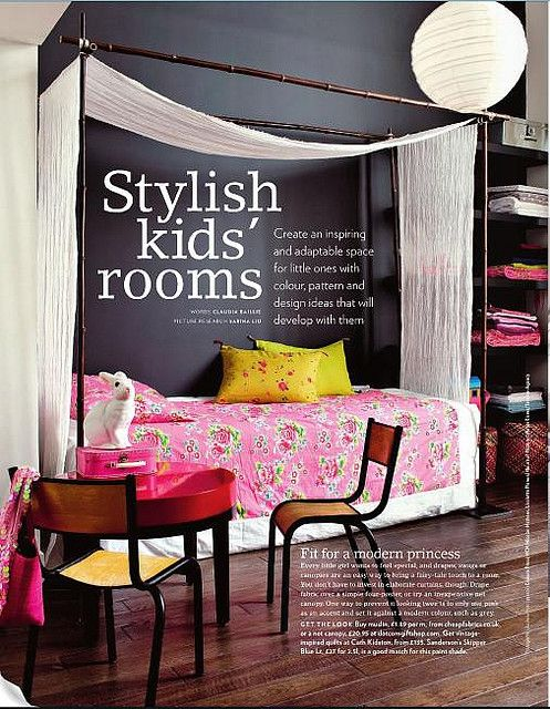 Love the bed ...pink flowered bedspread and dark grey wall - love dark walls for kids room !