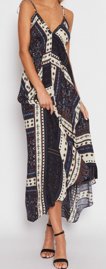 Optimize your comfort and beauty with this Aztec Dress. It features halter design, deep v and asymmetric hem.