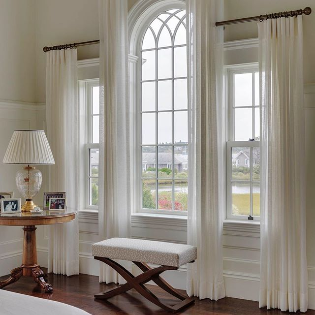Theme Tues   The graceful curves and elegant detailing of the Palladian window lends a sense of romance to this Master bedroom. We love the window treatment done by Cate Caruso @studio___c! #windows