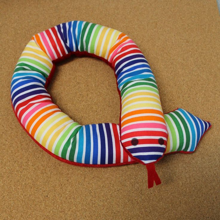 Make a weighted sensory snake to give comfort to a child including those with Autism, ADHD and Sensory Processing Disorder. Gina from Little DeMoura Designs show you how in a step by step tutorial. #nationalcraftmonth #attheheartofyourproject