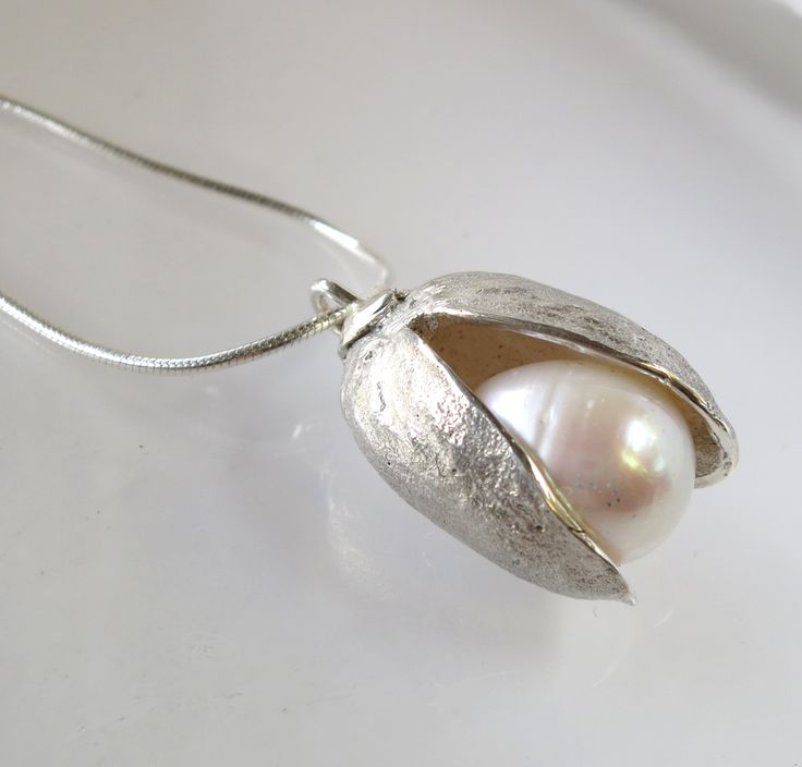 A freshwater pearl nestled inside my pistachio nut silver casting.    by Anna Vosburg