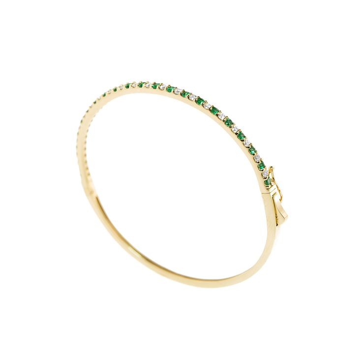 A lady's 14KY emerald and diamond bracelet featuring round cut natural emeralds and round brilliant diamonds. Available online and in store at Emeralds International LLC. View other variations of this bracelet as well. #emeraldbracelet