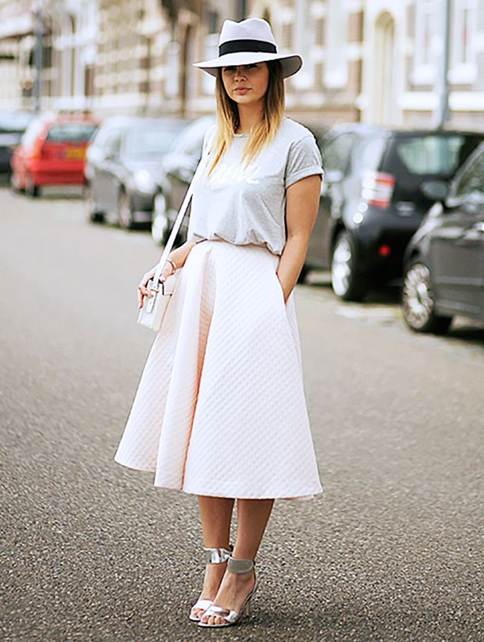 Basic t-shirt tucked into a full midi skirt with a wide brimmed hat and metallic silver heels