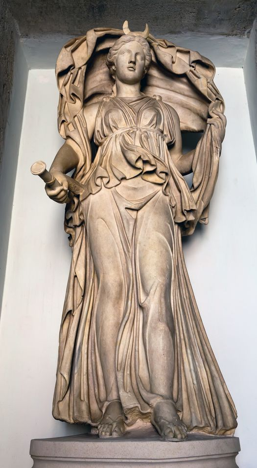 Ancient Roman statue depicting Selene - The goddess of the Moon, with her cloak billowing above her head. Description from depositphotos.com. I searched for this on bing.com/images