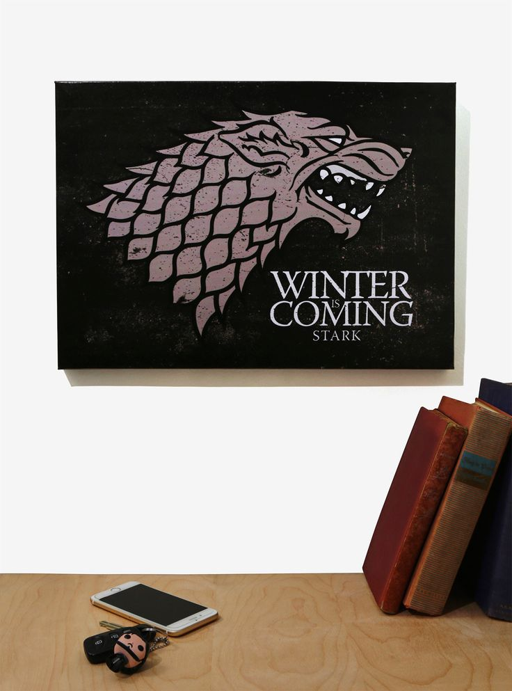"<div><i>When the snows fall and the white winds blow, the lone wolf dies but the pack survives. </i>- Eddard Stark</div><div><br></div><div>This black wall art features the House Stark sigil and their words, ""Winter is Coming."" <br></div><div><ul><li style=""list-style-position: inside !important; list-style-type: disc !important"">13"" x 19""</li&..."