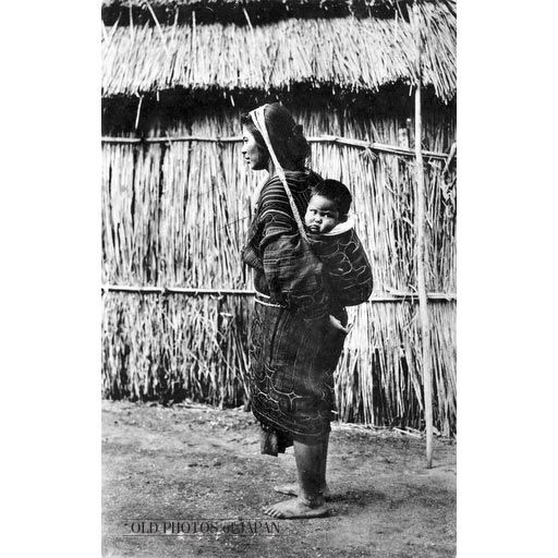 Ainu Mother & Child  garment or net was supported by a band round the mother's head