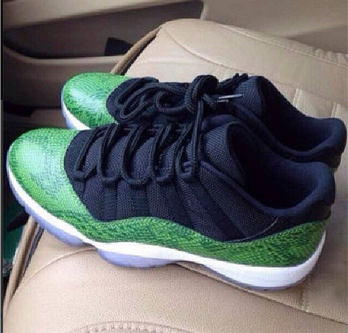 The Air Jordan 11 Low GREEN SNAKESKIN release date is set for April. Today,  a detailed look at the shoe. Black mesh is wrapped with green snakeskin  leath.