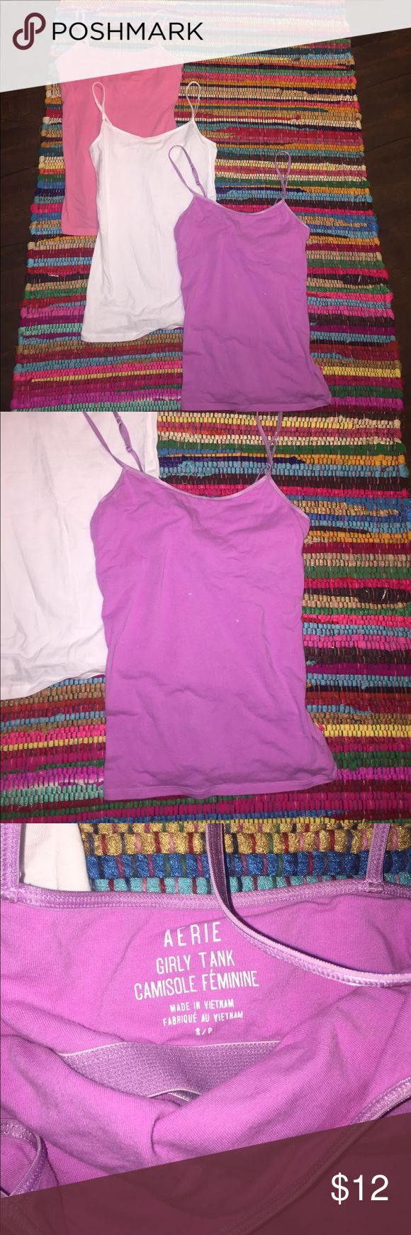 Cami PACKAGE DEAL 💕 Pink white and purple camis from Aerie and Aeropostale. White one has never been worn. Pink one in good condition besides small hole shown in picture, but still can be worn as an under shirt. Purple is in great condition besides two small bleach stains in middle of shirt so can be worn as undershirt still too! aerie Tops Camisoles
