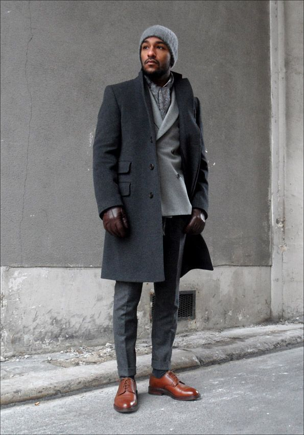 Choose a dark grey overcoat and dark grey dress pants to ooze class and sophistication. Opt for a pair of brown leather derby shoes for a more relaxed feel. Shop this look for $438: http://lookastic.com/men/looks/overcoat-double-breasted-blazer-gloves-beanie-dress-pants-derby-shoes-socks-scarf/1699 — Charcoal Overcoat — Grey Wool Double Breasted Blazer — Dark Brown Leather Gloves — Grey Beanie — Charcoal Dress Pants — Brown Leather Derby Shoes — Charcoal Socks — Grey Scarf