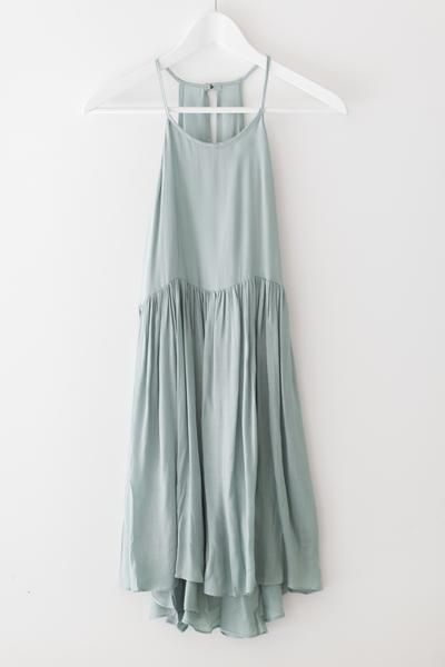 Delicate aqua colored dress with a high neckline and flowy high-low bottom. Keyhole back with button closure. Made with lightweight semi-sheer material.  100% R