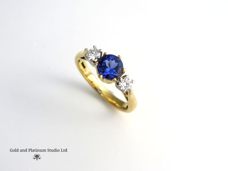 A beautiful tanzanite and diamond three stone ring. 18ct yellow gold with platinum settings for the diamonds. Designed and handmade in the studio by Mike.
