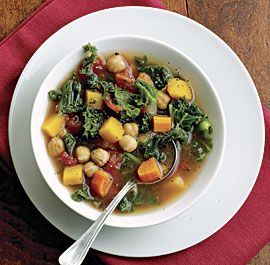 Autumn Vegetable Soup -  carrots onion  garlic  squash, tomatoes, kale and chickpeas