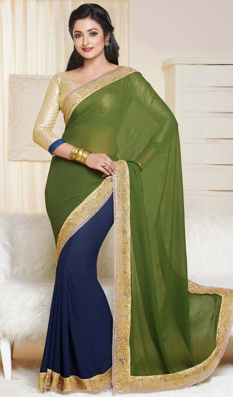 Classic aloe vera green and navy blue chiffon, georgette sari is a half n half sari with golden embroidery. The sari is garnished with decorative scalloped shape lace and golden silk thread embroidered border with intricate design which gives you grand and exquisite look. Sari pairs with contrast cream jacquard stitched blouse as shown in the picture. #LatestEveningWearSarees
