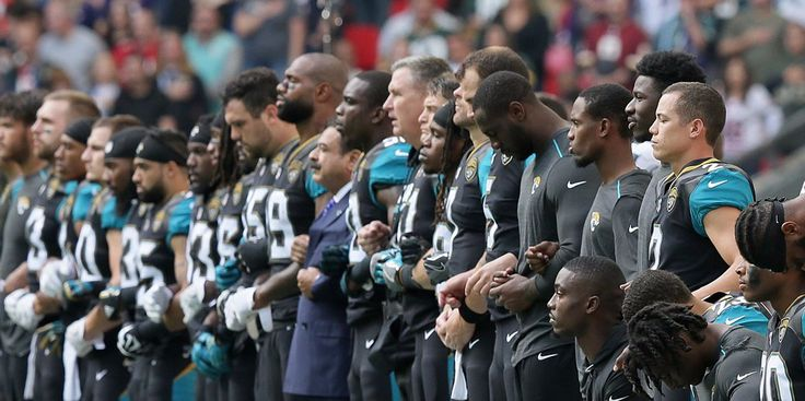 Jacksonville Jaguars owner Shahid Khan stood arm-in-arm with players during the national anthem