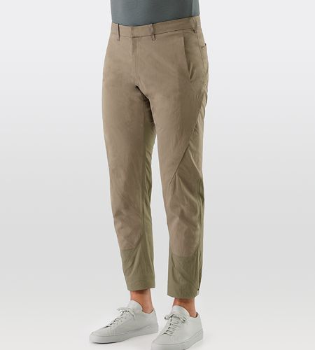 Apparat Pant Men's Slim fitting, articulated pants in a cropped length. Made with water-repellent cotton/nylon poplin for durability, paired with resilient stretch fabric for comfort and ease of motion.