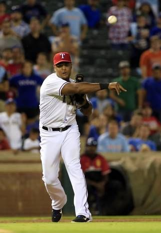 Aug 25, 2015; Arlington, TX, USA; Texas Rangers third baseman Adrian Beltre (29) makes a throwing error allowing the go ahead run to score during the ninth inning against the Toronto Blue Jays at Globe Life Park in Arlington. Mandatory Credit: Kevin Jairaj-USA TODAY Sports ORG XMIT: USATSI-217092