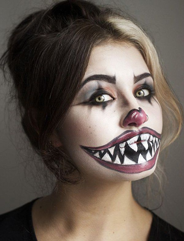 Horrifically magnificent Halloween makeup that you can recreate by yourself. Use dark and light colors that contrast against each other. This freaky clown makeup looks amazing because of the sheer contrast of the colors.