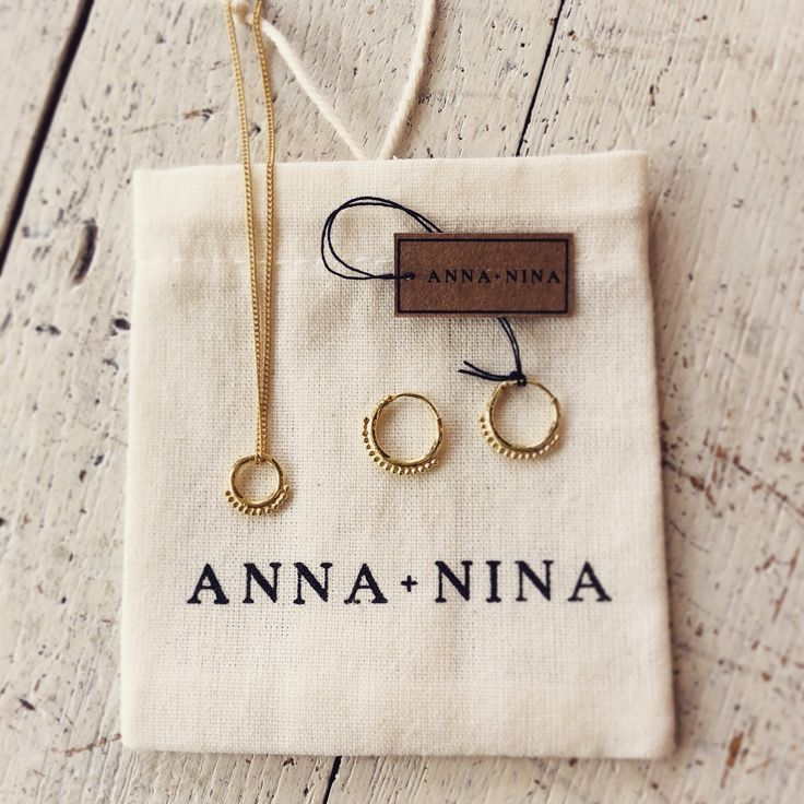 Anna + Nina dot hoop earrings and necklace in gold.
