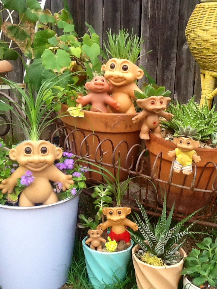 Adorable troll planters! Succulents