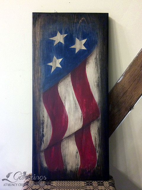"RUSTIC AMERICANA FLAG **Saturday May 21st 9:30 - noon Amy Smith Learn to paint ""freehand"" this patriotic wood piece using various techniques! 12""x 24"" hand painted and distressed flag. You may choose to hang it vertically or horizontally. (Cost $40+tax)"