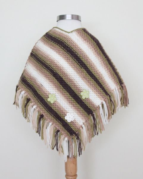 http://www.woollyandwarmy.com/collections/baby-pancho/products/baby-pancho-1