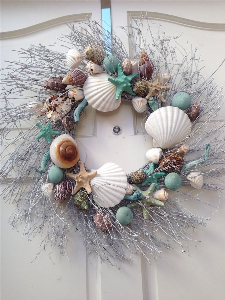 wreaths from dollar store, silver spray paint, and sea decor and hung by ribbon…