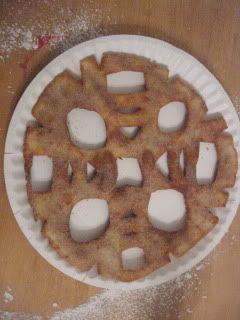 snowflake tortilla ~ just fold it, cut it, fry it, and sprinkle cinnamon sugar (or powdered sugar) on it