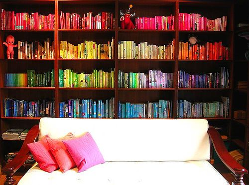 I will have a rainbow bookshelf one day, maybe a vertical white shelf with cookbooks for a sunny kitchen. http://hookedonhouses.net/2008/02/05/a-rainbow-of-books-organizing-by-color/