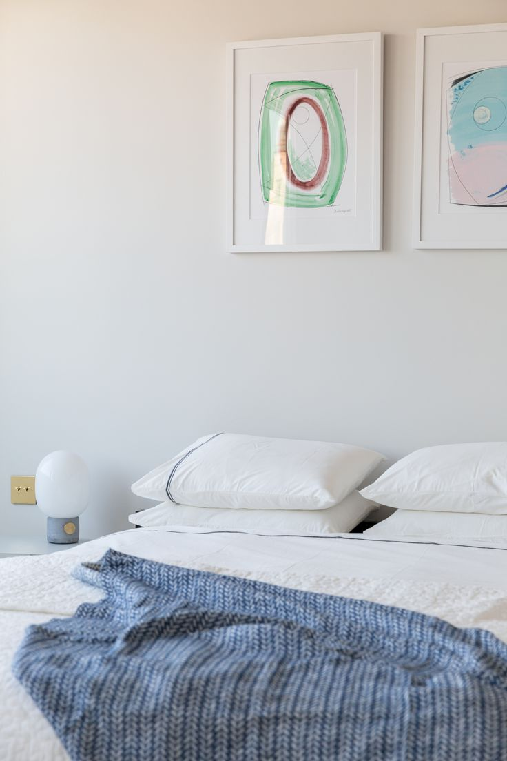 Modern master bedroom with white bedding. Designed by Studio Mills