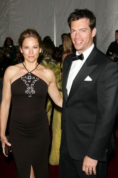 Harry Connick and some woman (wife Jill Goodacre...the former Victoria's Secret model I lost him too...woe is me!)