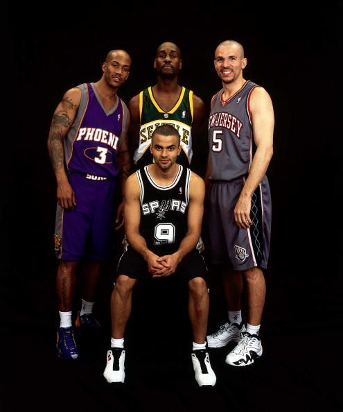 The Glove poses with Stephon Marbury, Jason Kidd and Tony Parker for the All-Star Game. You can tell Gary isn't impressed with his fellow All-Stars.