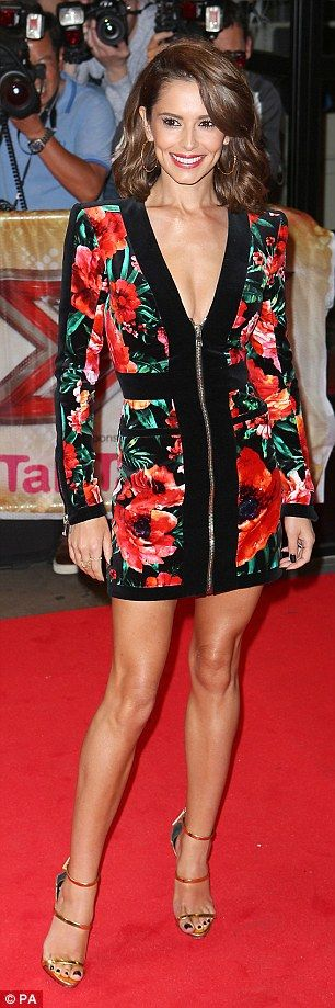 Looking leggy: Cheryl showed off her uber-bronzed legs in the dress...