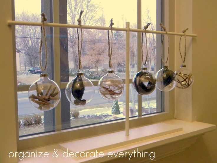 Filled Ornaments- With elements from nature .... can use feathers, twigs, or pine needles, holly leaves! Love these!!