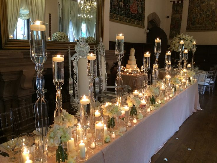 Top table setup for a wedding breakfast in the Drawing Room at Peckforton Castle. http://www.peckfortoncastle.co.uk/weddings