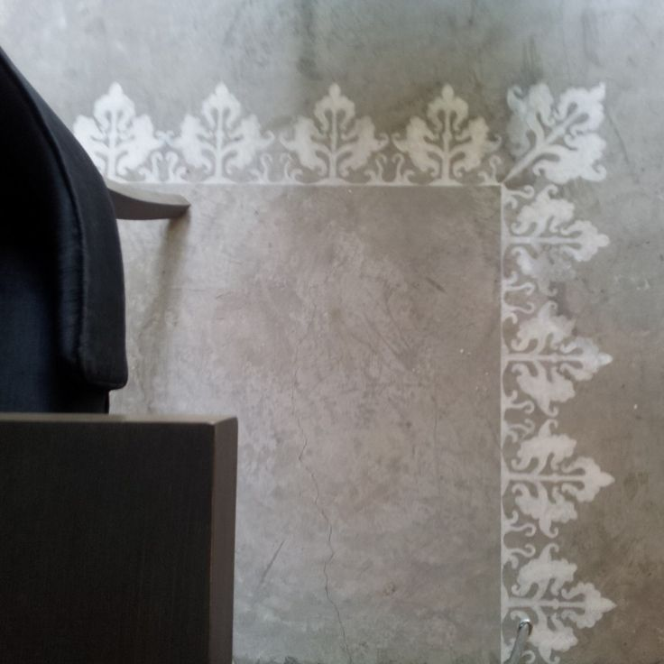 cement floor and hand-painted/stenciled pattern