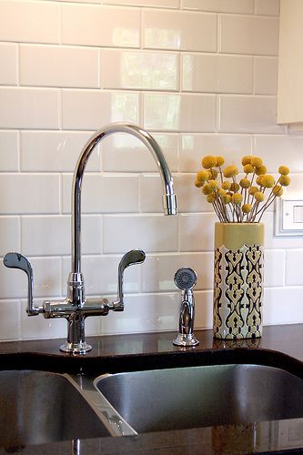 Glossy white porcelain subway tiles plus white grout (kitchen)