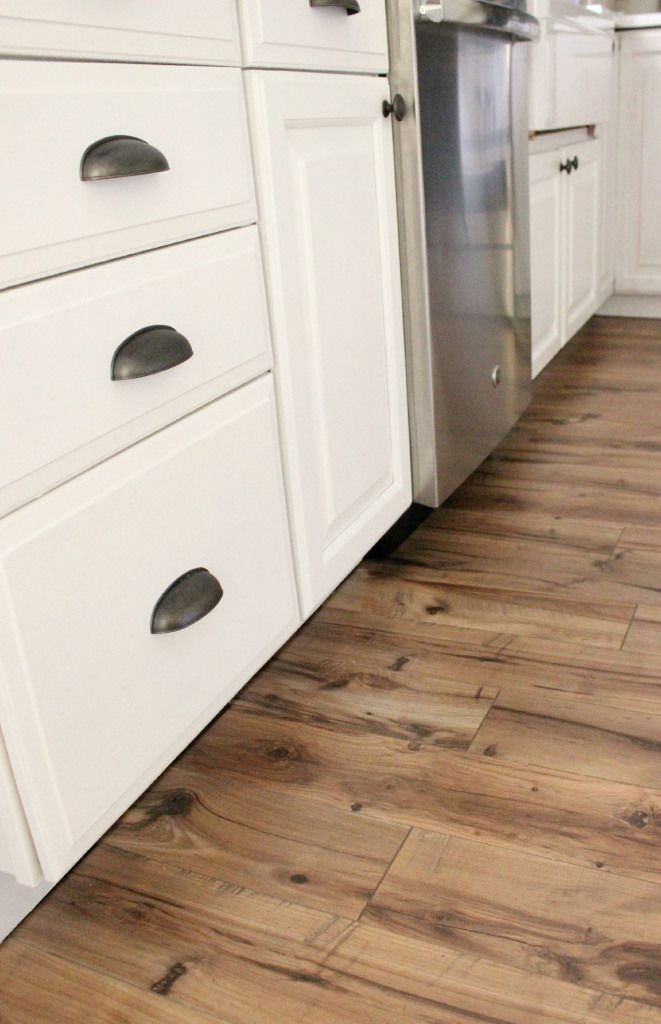 Laminate Flooring In A Kitchen laminate flooring kitchen delivered by inspire flooring aberdeen where a man is preparing a cup of Home Why And How We Chose Our Pergo Flooring