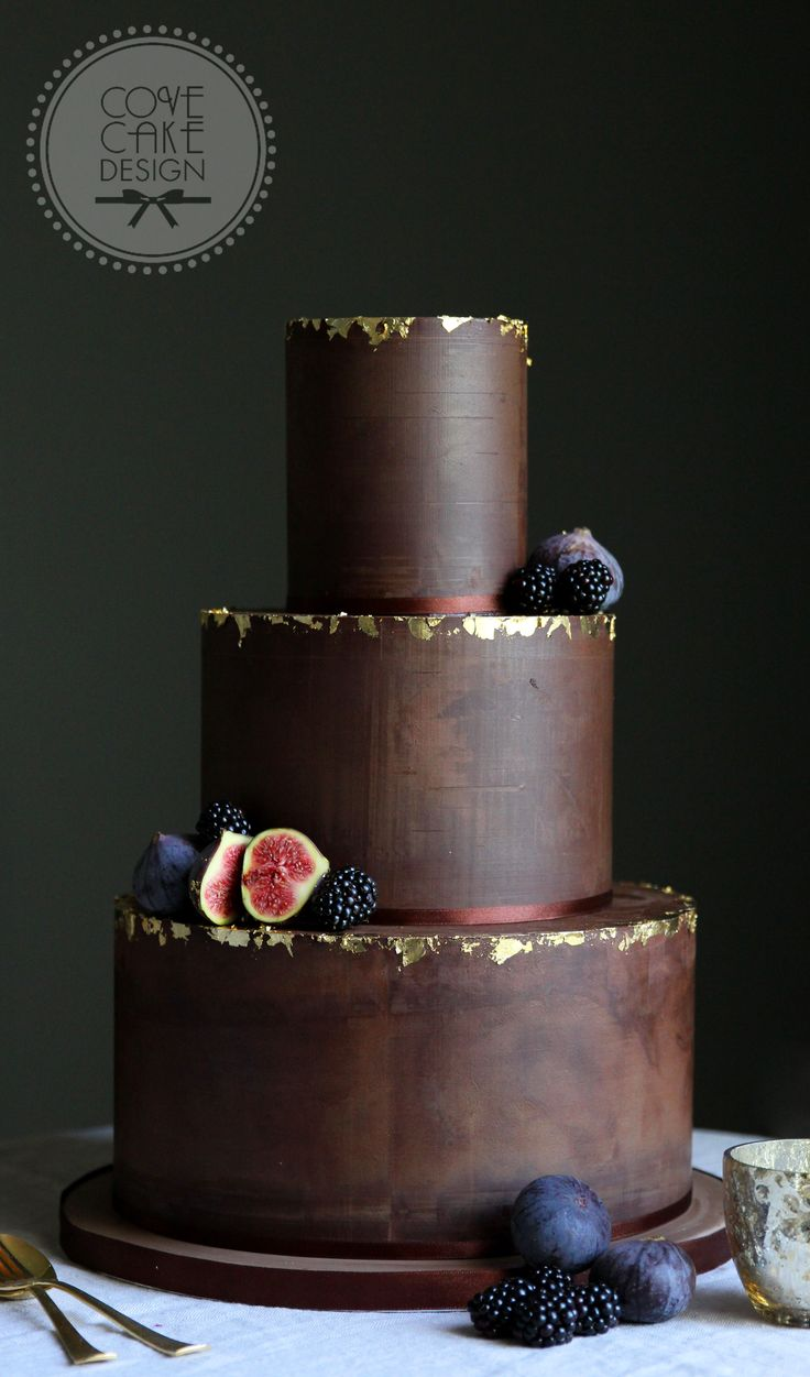 Dark Chocolate Ganache Wedding Cake with edible gold leaf and winter berries. Cake is Guinness Chocolate cake.