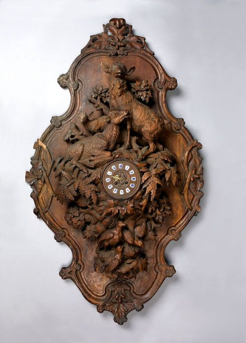 """Black forest carved wall clock, late 19th c., 47"""" h."""