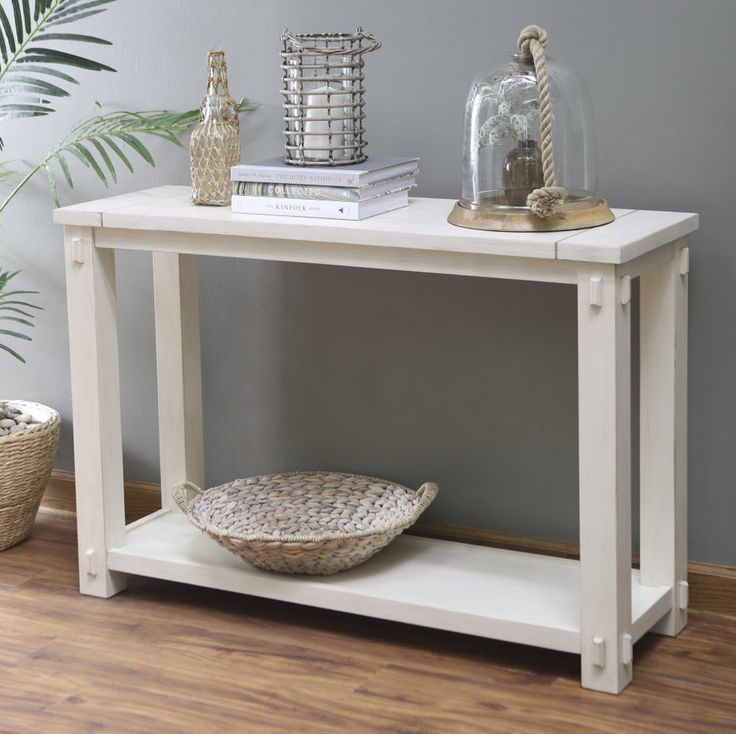 Slightly distressed antique white Mission style console table with wood plank tabletop design. Classic rectangle Mission Shaker Craftsman style accent table for living room spaces.