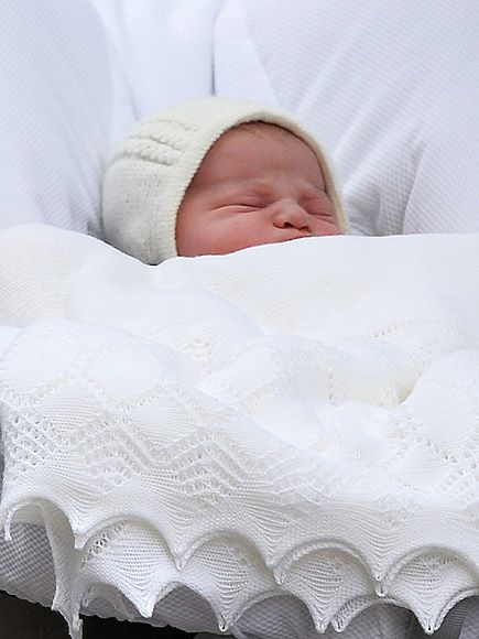 The New Baby Princess from Every Angle | | Wrapped in a white blanket and an ivory bonnet, the princess sweetly nestled in her mother's arms. Translation: She blissfully slept through her big debut, and it was perfect.