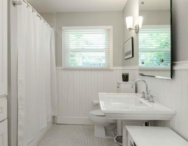 Image Gallery For Website Clean white bathroom Frameless mirror pedestal sink wainscoting