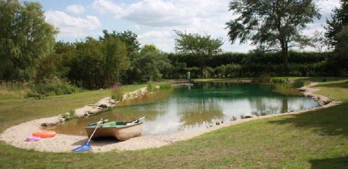 Convert a pond into a swimming pond. Mother Earth News says there are a few options as to liners - bentonite clay to seal the soil or a synthetic liner. If you choose a synthetic, they recommend ethylene propylene diene monomer rather than PVC. www.motherearthnews.com www.gartenart.co.uk