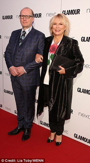Close pals: Dawn French opted for a typical black ensemble, jazzed up by silver shoes (L) while the evening's host Jennifer Saunders (R) layered a floral tee beneath a satin black coat (pictured with husband Ade Edmondson centre)