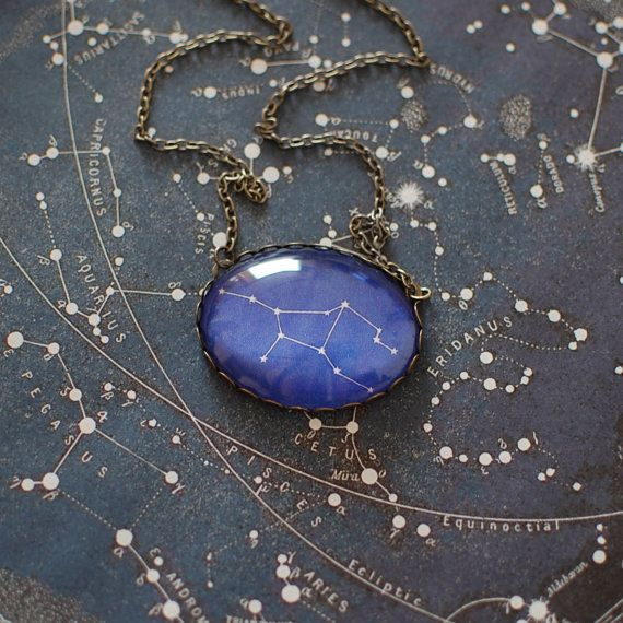 Zodiac constellation necklace - Virgo (23 August - 22 September). The necklace is made from bronze tone metal and a clear glass dome.